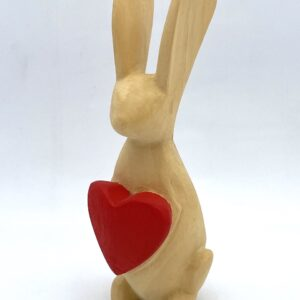 wooden carved bunny holding a red love heart