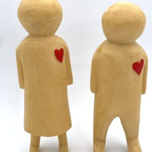 wooden hand carved people with red love hearts